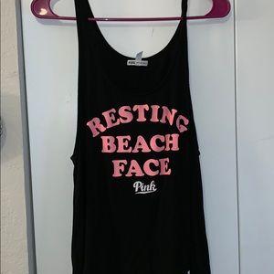 Pink Tank Top resting beach face